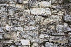 石老墙壁纹理 在老中世纪砖的岩石块 免版税库存照片