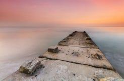 石跳船和风平浪静 免版税库存照片