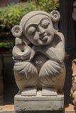 石雕象在庭院里装饰 免版税库存照片