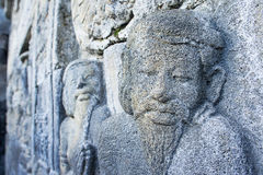石雕刻在婆罗浮屠墙壁上  免版税库存图片