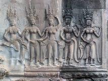 石雕刻在吴哥窟,柬埔寨的天使 图库摄影