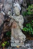 石雕刻在Wat Pho 免版税库存照片