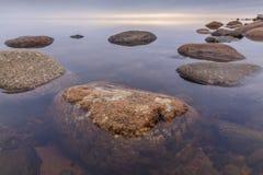 石头在日落的Ladoga湖 图库摄影