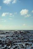 石头在风暴的海 免版税库存照片