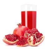 石榴在玻璃的果汁 免版税库存图片