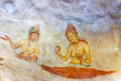 石洞壁画的,锡吉里耶,斯里兰卡五颜六色的妇女 库存照片