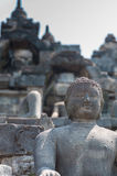 石头的坐的菩萨在婆罗浮屠,印度尼西亚 库存照片