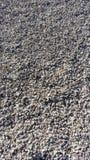石头背景在海滩的 库存照片