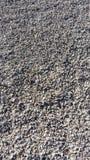 石头背景在海滩的 免版税库存照片