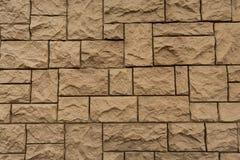 石头,对称地被排行的砖墙壁  免版税图库摄影