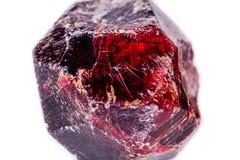 矿物石榴石石头的宏指令在白色背景的 库存图片