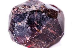 矿物石榴石石头的宏指令在白色背景的 图库摄影