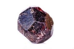 矿物石榴石石头的宏指令在白色背景的 免版税图库摄影