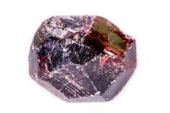 矿物石榴石石头的宏指令在白色背景的 免版税库存图片