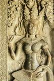 砂岩在吴哥窟,柬埔寨墙壁上的热衷的天使  库存照片