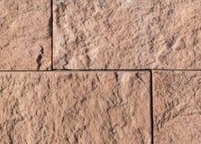 砂岩铺磁砖了墙壁 纹理,背景 免版税库存照片