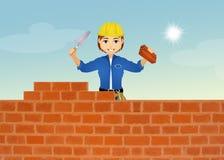 砌砖工修筑墙壁 免版税图库摄影