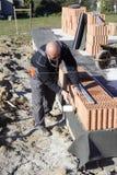 砌砖工重要资料 库存图片