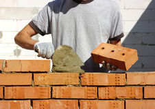 砌砖工 库存照片