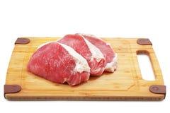 砍原始的猪肉 库存图片
