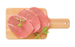 砍原始腰部的猪肉 库存照片
