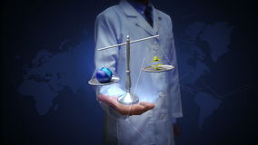 研究员、工程师、医生开放棕榈、平衡的地球和金币,金钱,地球 股票视频