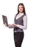 研究膝上型计算机的年轻微笑的妇女被隔绝 免版税库存图片