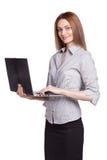 研究膝上型计算机的年轻微笑的妇女被隔绝 图库摄影