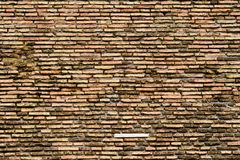 砖五颜六色的老墙壁 免版税库存照片