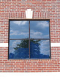 砖四paned红色墙壁视窗 免版税库存图片