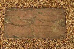 砖在沙子 免版税库存图片