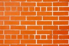 砖墙、地板和砖大块与一个颜色梯度的从红色到桔子 免版税图库摄影