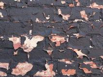 砖墙削皮油漆背景或纹理 库存照片