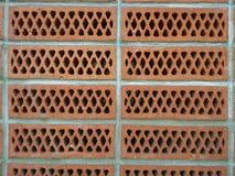 砖墙壁与孔的 免版税库存照片