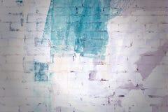砖墙抽象绘与白色和绿色油漆 与小插图,纹理的背景 图库摄影