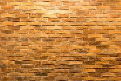 砖墙有轻的太阳背景 库存照片