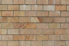 砖墙纹理背景 砖砌或石制品地板内部岩石老样式栅格砖设计堆 免版税库存照片