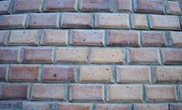 砖墙背景 砖水平线 红色和沙子砖在墙壁 关闭有块的墙壁 免版税库存图片