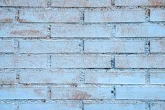 砖墙 在蓝色绘的砖墙 背景砖老纹理墙壁 图库摄影