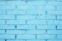 砖墙 在蓝色绘的砖墙 背景砖老纹理墙壁 库存图片