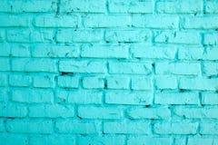 砖墙 在蓝色绘的砖墙 免版税图库摄影