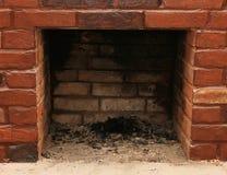 砖壁炉墙壁的背景 库存图片