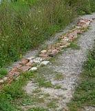 砖按照路 免版税库存照片