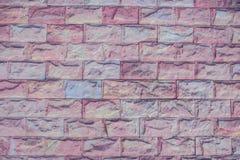 砖桃红色墙壁 库存图片