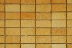 砖橙色纹理墙壁 免版税库存图片