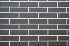 砖灰色墙壁,白色条纹 免版税库存图片