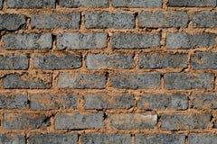砖灰色墙壁 免版税图库摄影