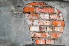 砖破坏墙壁 库存图片