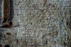 砖老纹理墙壁 年迈的石表面难看的东西背景  免版税库存图片