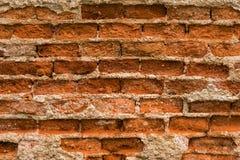 砖破裂的墙壁 免版税库存照片